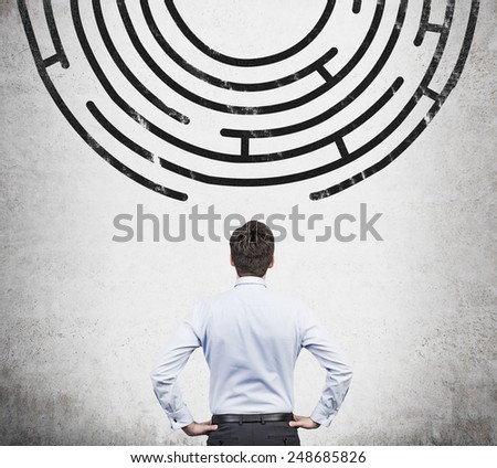 businessman looking to out way of the labyrinth - stock photo
