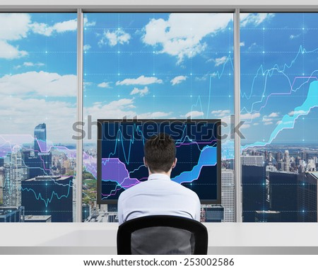 businessman looking to screen with forex chart - stock photo