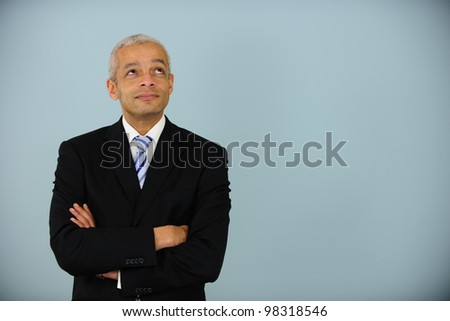 businessman looking up at copyspace - stock photo