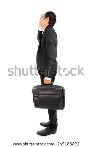 Businessman looking up isolated on over white background