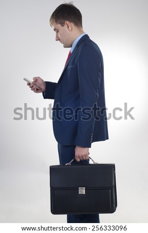 Businessman  looks at the mobile phone