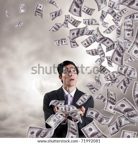 businessman loosing money from his hands (isolated on white) - stock photo