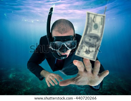 Businessman lured by money - stock photo