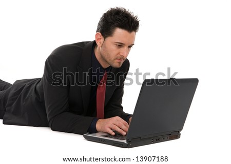 Businessman lying down working with the laptop computer