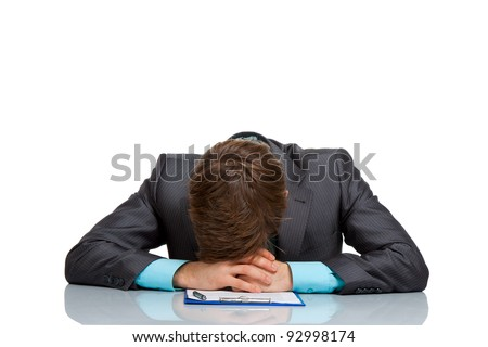businessman lying on the desk tired, resting head on document sleeping, concept of handsome young business man stress, depressed wear modern elegant suit sitting, isolated over white background - stock photo