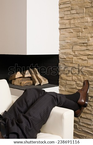businessman lying on the sofa  - stock photo