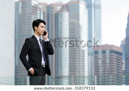 Businessman make a call on cellphone at outdoor - stock photo