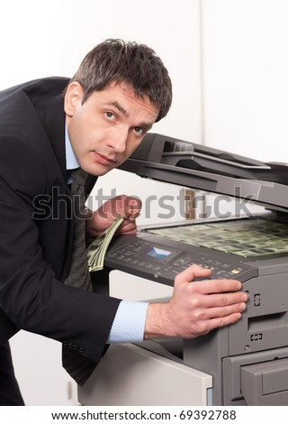 Businessman make false money on copy machine in office
