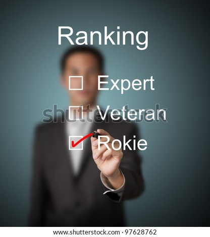 businessman make red mark on rookie ranking