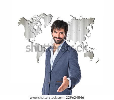 businessman making a deal over atlas background