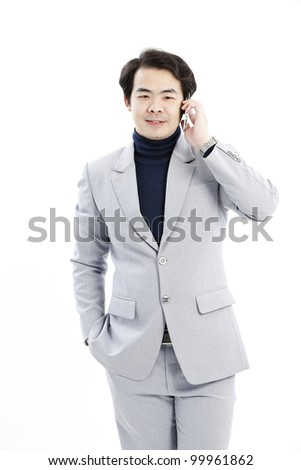 Businessman making a phone call against a white background