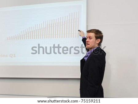 Businessman making a presentation - stock photo