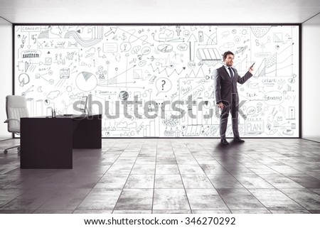 Businessman making a presentation in his office - stock photo