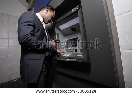 Businessman making a withdrawal