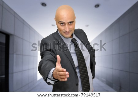 Businessman making an offer and a good deal - stock photo