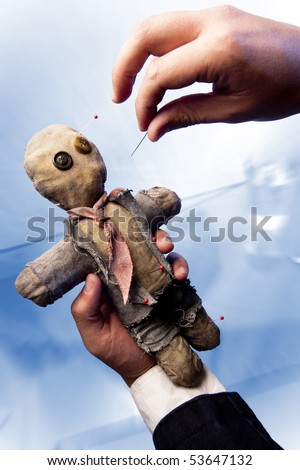 businessman making harm to coworker via voodoo - stock photo