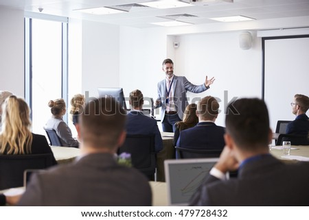 Businessman Making Presentation At Conference