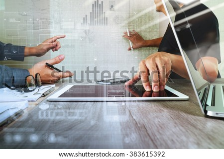 Businessman making presentation with his colleagues and business strategy digital layer effect at the office as concept           - stock photo
