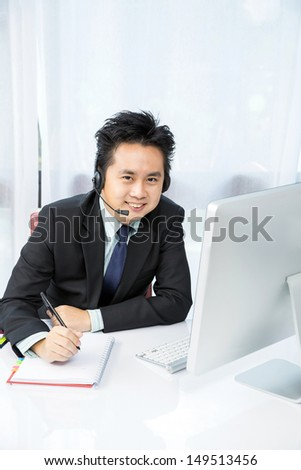 businessman making tele conference with desktop computer