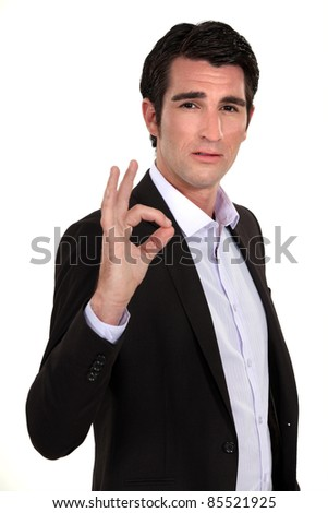 Businessman making the OK sign