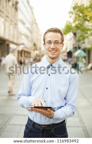 Businessman Man Using Tablet Computer in public space