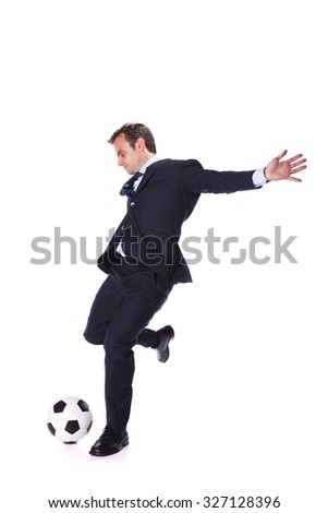 Businessman manager kicking a soccer ball - stock photo