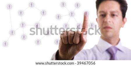 businessman managing her contact network, pressing hi-tech buttons on a whiteboard (selective focus) - stock photo