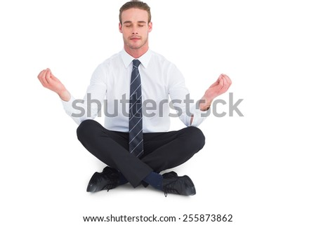 Businessman meditating in lotus pose on white background