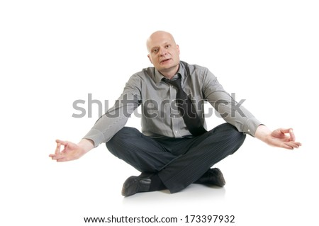 Businessman meditating in lotus position.Concept of business yoga