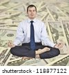 businessman meditating in yoga lotus. Isolated on bill backgroun - stock photo