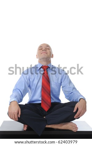 businessman meditating in yoga lotus. Isolated on white background - stock photo