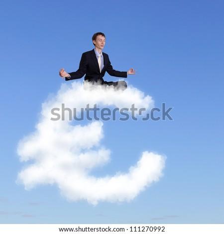 Businessman meditating sitting on the white cloud - stock photo