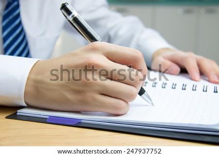 Businessman meeting to take notes - stock photo