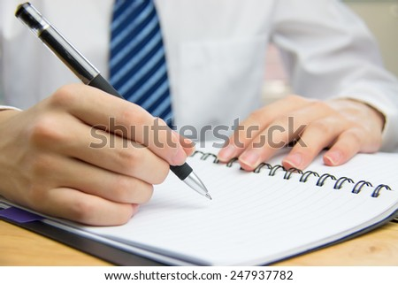 Businessman meeting to take notes