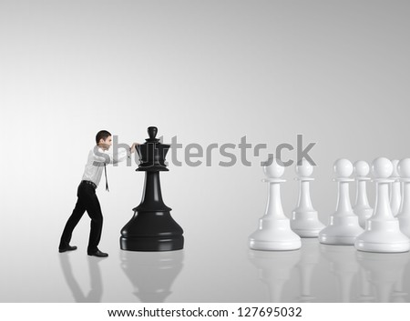 businessman moving chess  on gray background - stock photo