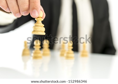 Businessman moving pawn chess figures. Concept of business strategy. - stock photo