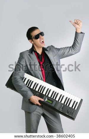 Businessman musician playing instrument with suit and tie - stock photo