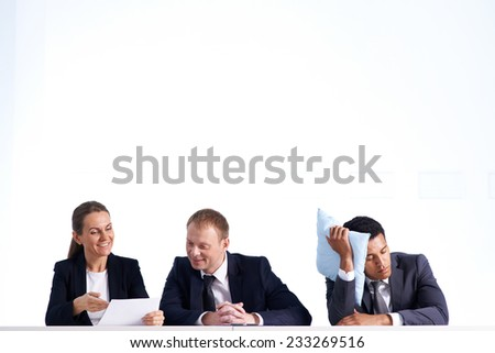 Businessman napping while his colleagues communicating - stock photo
