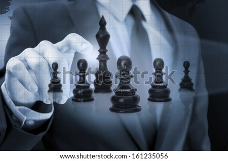 Businessman navigating chess figures in virtual space. Concept of business strategy. - stock photo