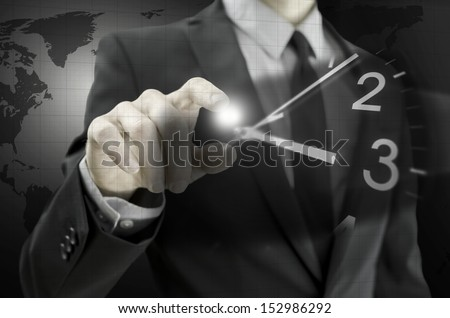 Businessman navigating virtual clock in virtual space. Concept of importance of time in business or time is money. - stock photo