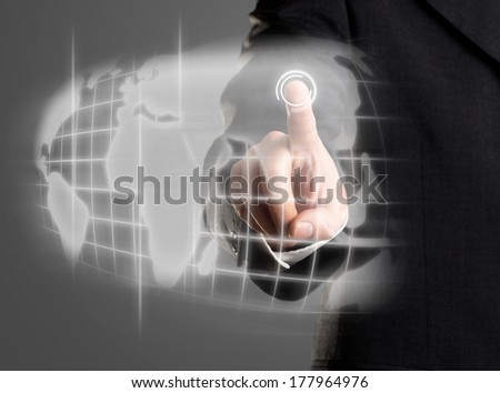 Businessman navigating world map on futuristic touch screen display