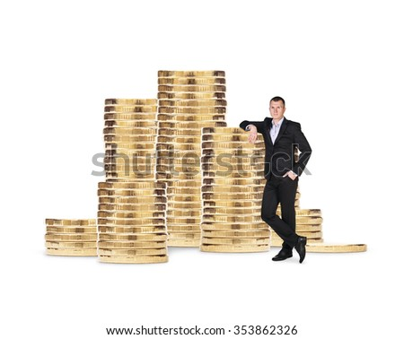 Businessman near stack of golden coins isolated on the white background