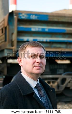 Businessman near train - stock photo