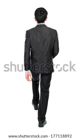 Businessman not facing the camera and step up. isolated over white background - stock photo