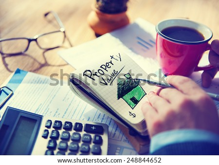 Businessman Notepad Property Value Concept - stock photo