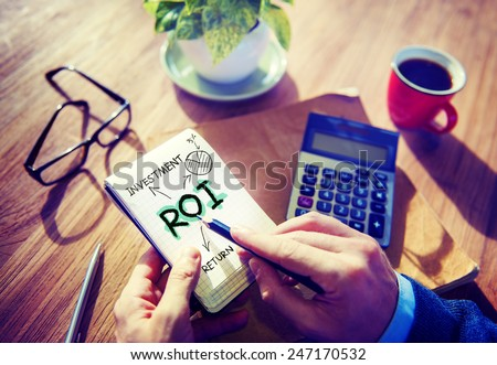 Businessman Notepad Roi Word Concept - stock photo
