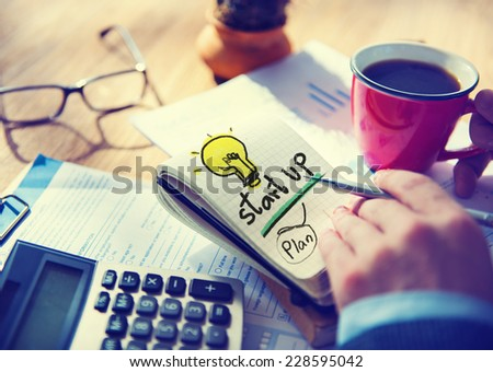 Businessman Notepad Startup Plan Concept - stock photo