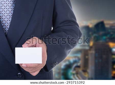 Businessman offer  business card to persuade investors - stock photo