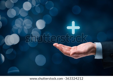 Businessman offer positive thing (like benefits, personal development, social networking) represented by plus sign, bokeh in background. - stock photo