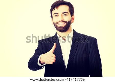 Businessman offering a handshake. - stock photo